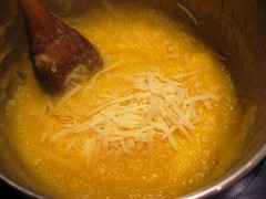adding cheese to the cornmeal