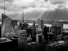 Top of the rock: amazing light over Manhattan (nicolaspika) Tags: holidays spring manhattan cloudy topoftherock city light newyork olympus rayoflight skyscraper blackandwhite trip travel noiretblanc ny nyc architecture usa clouds sky bw unitedstates us