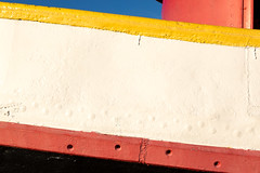 Tug (josullivan.59) Tags: wallpaper white 3exp evening red texture yellow orange ontario outside park artisitic abstract sunsetlight day detail geometric hamilton light canon6d canada clear canonef24105mmf4lisusm blue nicelight minimalism september 2016 closeup lines