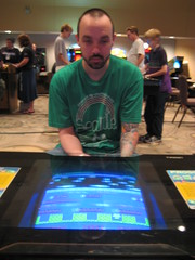 OneHandedTerror playing Frogger on a classic arcade cabinet