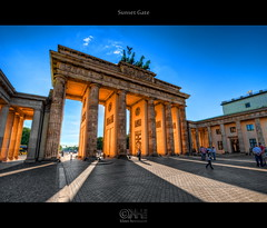 Sunset Gate (HDR) (farbspiel) Tags: travel sunset red vacation orange holiday colour berlin history tourism colors sunshine yellow photoshop germany logo geotagged photography nikon colorful colours wideangle brand