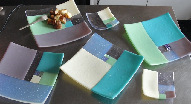 Four fused glass dinner plates plus two small sushi plates in a Fibonacci inspired design in tones of turquoise, green, lavender and cream