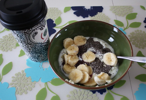 coffee Jonathan Adler cup, yogurt with banana, chia seeds, strawberry jam