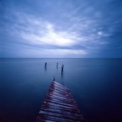 Discord:Redux (Dr. RawheaD) Tags: ocean longexposure blue red sky cloud bird water pier still dock quiet fuji belize calm minimal hasselblad 100 provia cayecaulker swcm