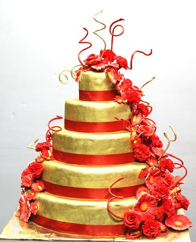 Red Gold 5 tier Wedding cake with Floral sugarflower arrengement
