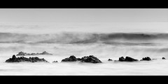 Swallowed (ViewsOfIreland.com) Tags: ocean ireland sea blackandwhite bw seascape monochrome landscape inch waves cork rapid raging churning