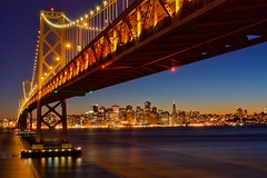 Bay bridge and San Francisco skyline at dusk