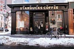 Caffeine Reflections (Georgie_grrl) Tags: windows winter snow toronto ontario bicycle reflections cafe downtown starbucks pentaxk1000 coffeehouse rikenon12828mm kingstreeteastithink