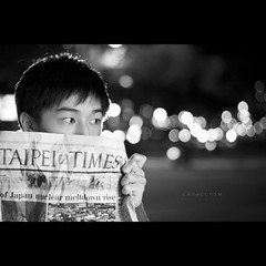 196/365 Cataclysm (brandonhuang) Tags: light boy blackandwhite bw white black monochrome japan canon paper lights newspaper nikon bokeh flash monochromatic times taipei strobe strobes 500d ef50mmf18 430ex strobist sb900 brandonhuang rebelt1i