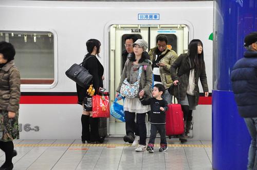 Japan Earthquake: kids leaving Tokyo from Haneda airport