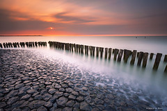 Breaking the Water (Harold van den Berge) Tags: beach bigstopper breakwater canon1635lf4 clouds golfbreker haroldvandenberge landscape landschap leefilter longexposure lucht netherlands nieuwvliet noordzee northsea outdoor paal paalhoofd rocks sky stenen strand sunset water wolken zeekust zeeland zeeuwsvlaanderen zonsondergang luminositymask