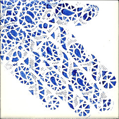 Stenciled henna pattern on ceramic tile