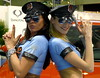 Pistolero girls (e³°°°) Tags: ladies girls brussels portrait cars sunglasses tattoo women uniform duo duet police bruxelles portraiture babes portret brussel autosalon carshow arrest armed ssangyong bxl pistoleros nogun policesquad carshowwomen fingershooting
