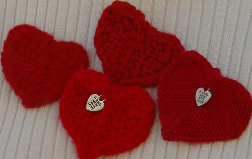4 hearts 2 patons classic wool 1 felted 1 unfelted  then 1 red heart doubled then 1 fingering yarn