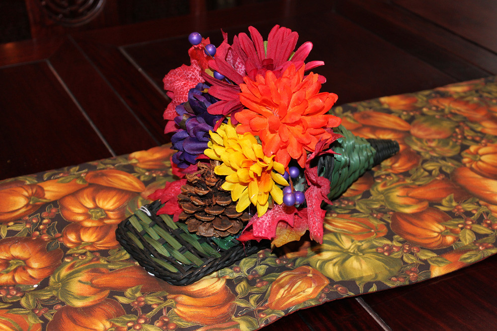 Thanksgiving green cornucopia basket with artificial flowers