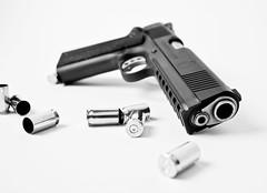 Operator (DannyLongIsland) Tags: bw shells white black canon gun dof 45 pistol 5d highkey bullet apollo speedlight softbox operator reflector 1911 firearm onelight 35l strobist