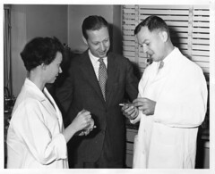 (left to right): Fern P. Rathe, Karl August Folkers (1906-1997), and Edward Anthony Kaczka (b. 1914) (Smithsonian Institution) Tags: 1955 standing private three chemistry blinds labcoat antibiotic scientists researcher chemist biochemistry smithsonianinstitution merck 2011 womenshistorymonth womeninscience smithsonianinstitutionarchives 20thcenturymid