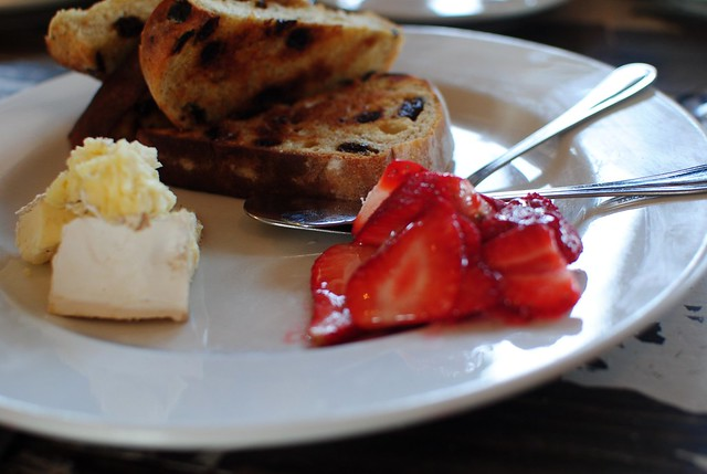 raisin bread, sweet strawberries, and creamy brie-type cheese