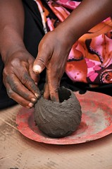 Rough Shaping (Lauren Barkume) Tags: africa pink red woman house black building floral rural circle southafrica design sticks hands pattern village handmade african traditional small large craft pot pots clay pile pottery ash rough ochre making graphite artisan venda limpopo crafter tsonga mashamba gettyimagesmeandafrica1