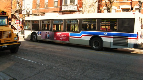 A First Student school bus meets a Chicago Transit Authority transit bus on West Taylor Street. Chicago Illinois USA. Wednsday, March 16th, 2011. by Eddie from Chicago