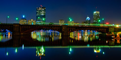 Longfellow Bridge & Boston Skyline at Night (Red Line Series No. 11) (briburt) Tags: longexposure bridge blue cambridge light sunset sky urban panorama orange building water yellow boston skyline architecture night clouds skyscraper marina reflections river landscape boats evening pier dock nikon colorful cityscape angle dusk availablelight pano massachusetts charlesriver wide azure indigo trails newengland wideangle shore moonlight lighttrails mbta nightphoto sailboats streaks redline johnhancock prudential backbay banks longfellow longfellowbridge hancocktower urbanlandscape prudentialbuilding deepblue bostonskyline bostonist johnhancocktower d90 bostonbackbay nikond90 flickrgolfclub supermoon northofnormal briburt bostonbackbayskyline