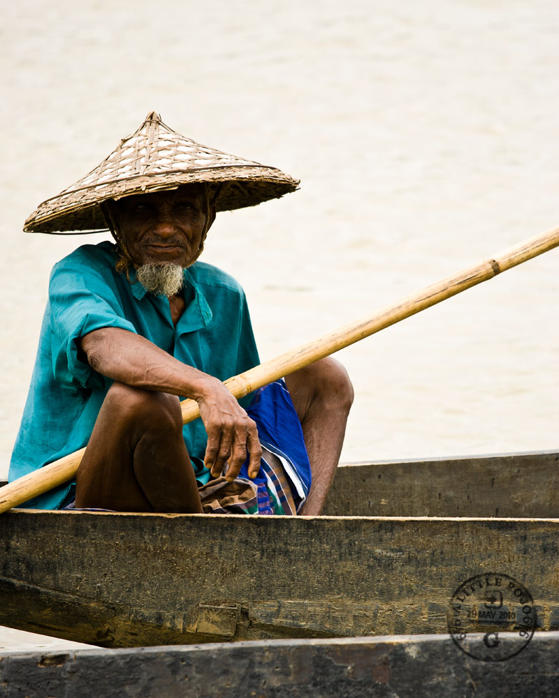 A river boatman on the Surma River, near Sylhet, Bangladesh