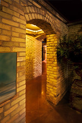 Mercato Corridors (ETCphoto) Tags: lighting brick thevillage michigan arches traversecity corners corridors smallshops gtcommons oldbuilding50