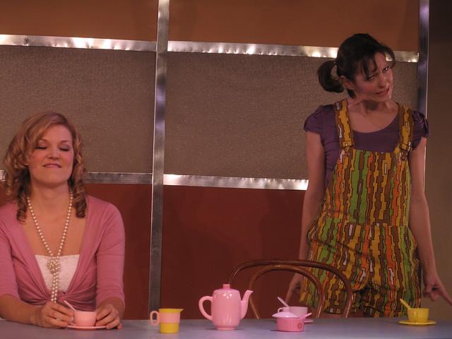 Macey is smug.  Elizabeth is angry.