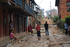 A typical day: Nepali kids hanging out and playing in the street (www.mahliaamatina.com) Tags: nepal playing beauty smiling happy nikon creative smiles games catching simplicity barefoot balconies alive hopscotch connected ethnic playinggames inspiring hangingout humble throwing ground grounded nepali uplifting childrenplaying nepalichildren typicalday cobbledstreet brown skin motivating bare nikon no being simple smile lives d3000 living mixed shoes without socks melting ethnicity beings barefoot d3000 livingidle
