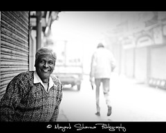 Morning Smile : ) [EXPLORE] Feb 14 2011 (Mayank Sharma renewed :D :D) Tags: road street morning portrait bw india man smile canon walking market walk delhi streetphotography oldman photowalk shops tone chandnichowk teastall