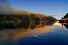 Final sunset on Francois (Rick Gravelle) Tags: sunset mountains ferry newfoundland reflections nikond70 fjord nik fishingvillage topaz canvastexture francois southcoastofnewfoundland