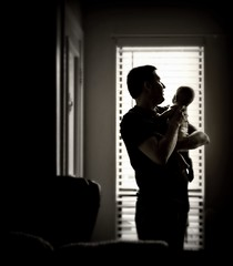 At the window ([ images by stacy ]) Tags: light baby love window infant dad father trent fathersandsons hold hensley
