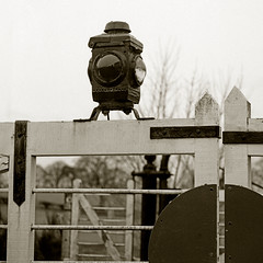 2011-02 train crossing lamp (chapelcross6) Tags: mamiya c330 sekor 135mm ilford delta400 ilfosol bw tlr mf railroad railway britain uk antique lamp light signal oil filter red
