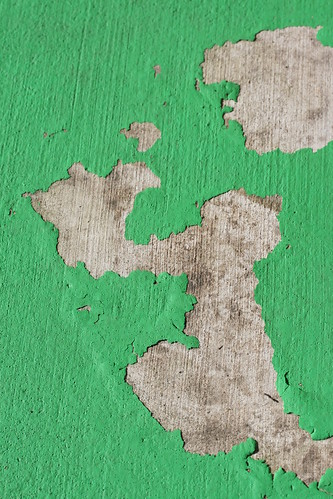 Chipped Green Paint on Concrete