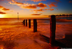 The Sunrise Wave (JDSaunders Photography) Tags: ocean red sea orange sun motion blur beach water clouds sunrise pier movement sand nikon exposure waves crash south vivid calm devon marker serene sets tranquil density groynes neutral teignmouth d40 nd110 magicseaweed