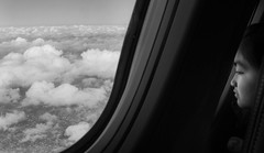 Possibilities (abso847) Tags: clouds flight girl dreams possibilities chicago cancun mexico bw airplane olympus wide angle