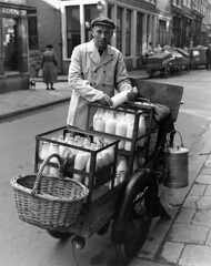 09-24-1953_11815 Melkboer (IISG) Tags: pet man male work milk workers basket labor cap labour worker werk melk arbeid milkman mand milkbottle occupations bakfiets professions beroepen benvanmeerendonk melkboer melkfles melkventer