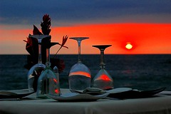 Dining Out (Serge Freeman) Tags: ocean sunset sun colors dinner mexico restaurant glasses cafe puertovallarta