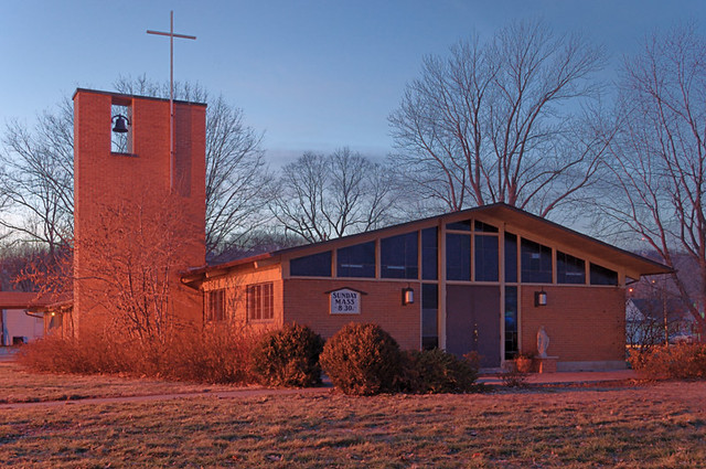 Mary Queen of Peace Catholic Mission, in Clarksville, Missouri, USA - exterior at sunset