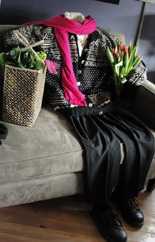 Norwegian sweater, black pants, and Doc Martens posed like a person, with tulips and shopping basket