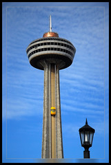 Skylon Tower, Yellow Elevator & Lamp (alicem51) Tags: ontario canada lamp bluesky niagara falls skylontower softclouds yellowelevator climbingtothetop