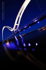 Infinity Illuminated (ScudMonkey) Tags: light canon evening footbridge dusk illumination sigma explore slowshutter lit stocktonontees ultrawideangle rivertees thornabyontees paulbradley 5dmkii infinitybridge 1224mmf35exdg