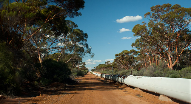 Alongside the pipeline, away from the highway