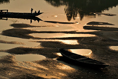 The Land of Gold, literally. [..Manikganj, Bangladesh..] (Catch the dream) Tags: winter sunset people reflection water landscape boat dry sands riverbank bangladesh dryseason manikganj goldenland anchoredboat driedupriver landofgold winterinbangladesh catchthedream mohammadmoniruzzaman gettyimagesbangladeshq2