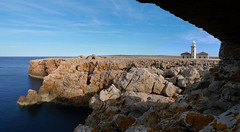 Panoramic viewpoint at Punta Nati from a farmer's shelter (Bn) Tags: lighthouse building stone landscape island coast spain farmers hiking north mountainbike scenic lagoon unesco walker age biospherereserve edge stunning coastline shelter nudity shag vuurtoren menorca shags mediterraneansea seabirds spanje clearwater minorca deepblue dwelling unspoiled balearicislands bluesea balearics rockycoastline naturists palebluesky deepbluesea puntanati mediterraneanlandscape naturalenvironments rockyoutcrops crystalbluesea rurallocation untouchedbeaches turquoisebluewater caminosnaturales cormorantfamily geomenorca nestingontherocks aerobicdiving smallcaves serenebluewater tranquilunspoiltplace shelteredcoves crystalclearblue unspoiledshores wonderfulclimate barefacedcliffs