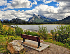 A Getaway in Banff (Jeff Clow) Tags: travel mountain lake canada mountains nature bench landscape bravo quiet view getaway peaceful vista serene mountrundle albertacanada banffnationalpark canadianrockies