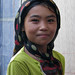 Friendly young Uyghur girl at silk factory - Hotan, Xinjiang, China