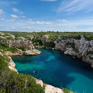 Snorkeling in the blue coastal inlet of Cales Coves