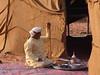 0169 Dubai, UAE (Traveling Man – Traveling, back soon) Tags: canon 50d dubai unitedarabemirates uae arabianpeninsula southwestasia persiangulf cane man coffee pot tray tent carpet sand heritagevillage alshindagha arab canoneos50d canonef28135mmf3556isusm markaveritt muslim