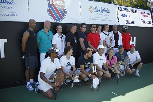 Professional and Amateur players join for a group photo before the days matches begin.